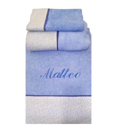 juegos de toallas:3 piezas bordadas con nombre y con cenefa de tela en la parte inferior.